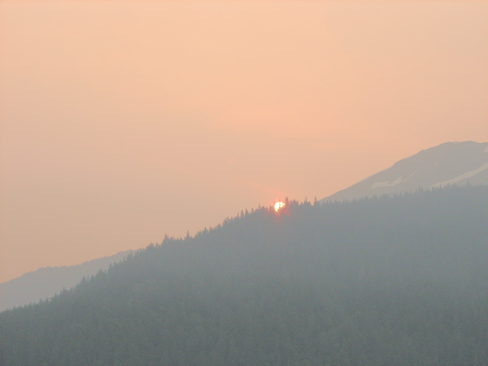 Sun Rising Over Smoke Obscured Mt. Roberts.