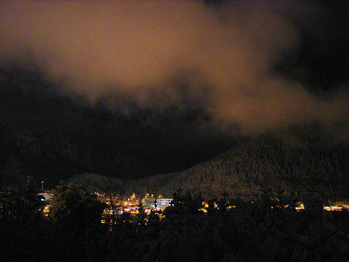 Lights of Juneau Lighting Snow on Mt. Roberts and Clouds.