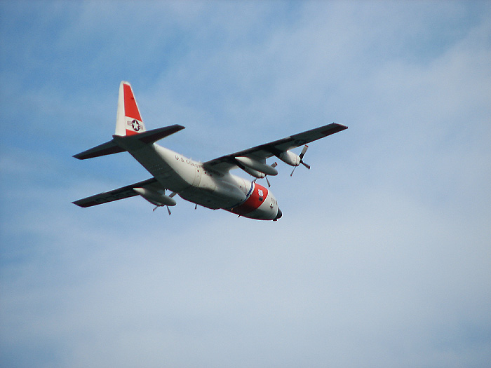 U.S. Coast Guard C-130 Aircraft flying SE (above Gastineau Channel).
