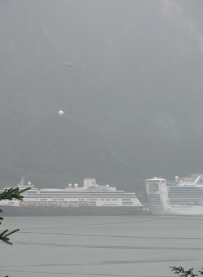 Coastal Helicopters flying a new Radome to Holland America Line's Statendam (not visible).