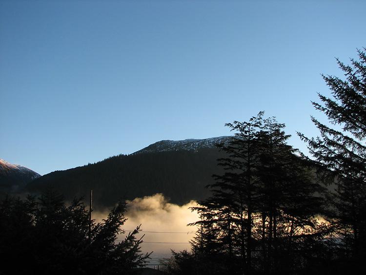 Sun On A Layer Of Fog.